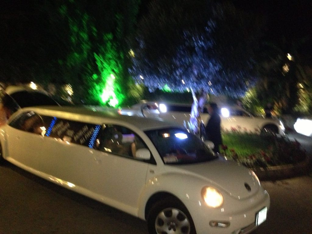 White beetle limousine from the side