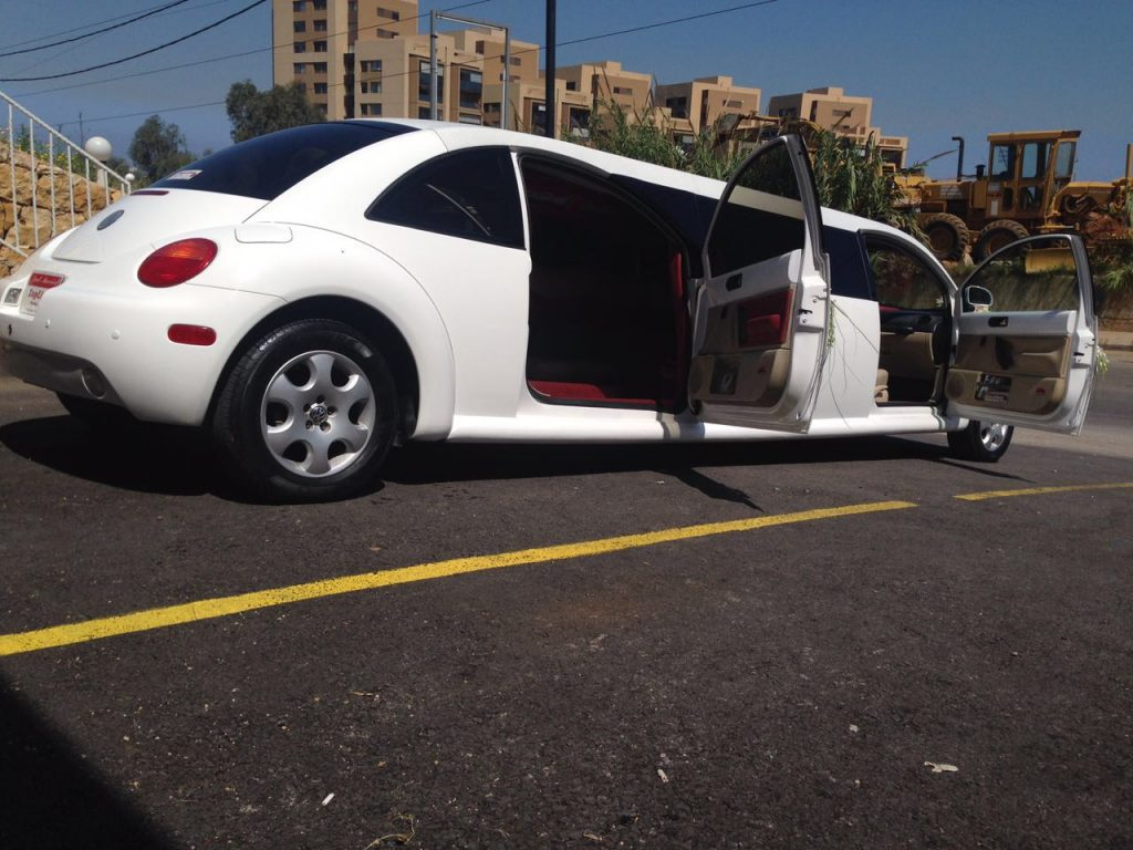 White beetle limousine with doors opened