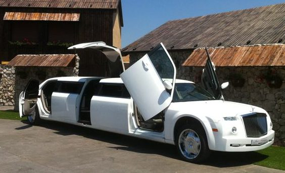 Limousine with Jet doors wide open and a green village set up