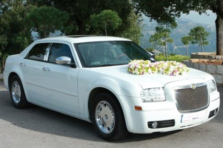White Chrysler 300 C decorated for weddings with a Lebanese plate number