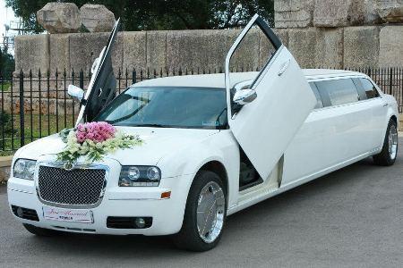 regular chrysler white limousine decorated for bride