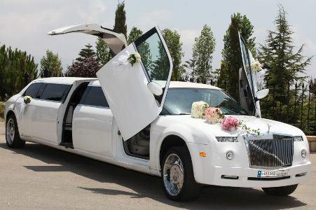 Luxury Phantom limousine with jet doors open and flower decoration