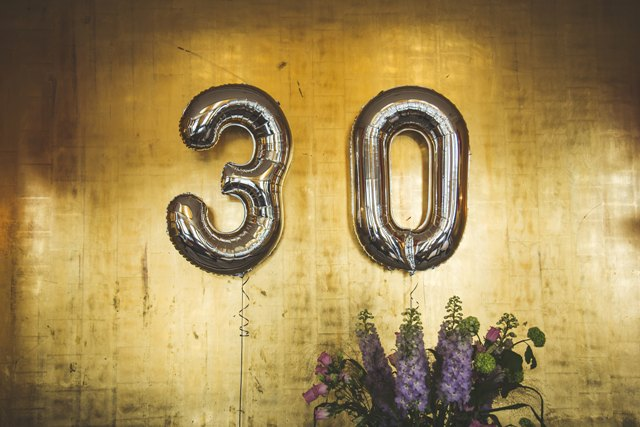 The number thirty in balloons and lavender decoration